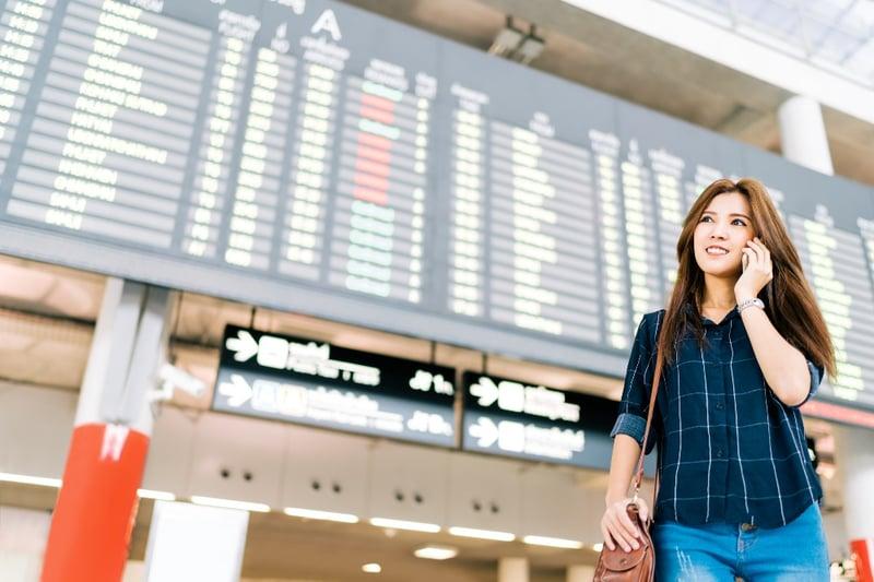 woman-on-phone-station-airport-departure-blog.jpg