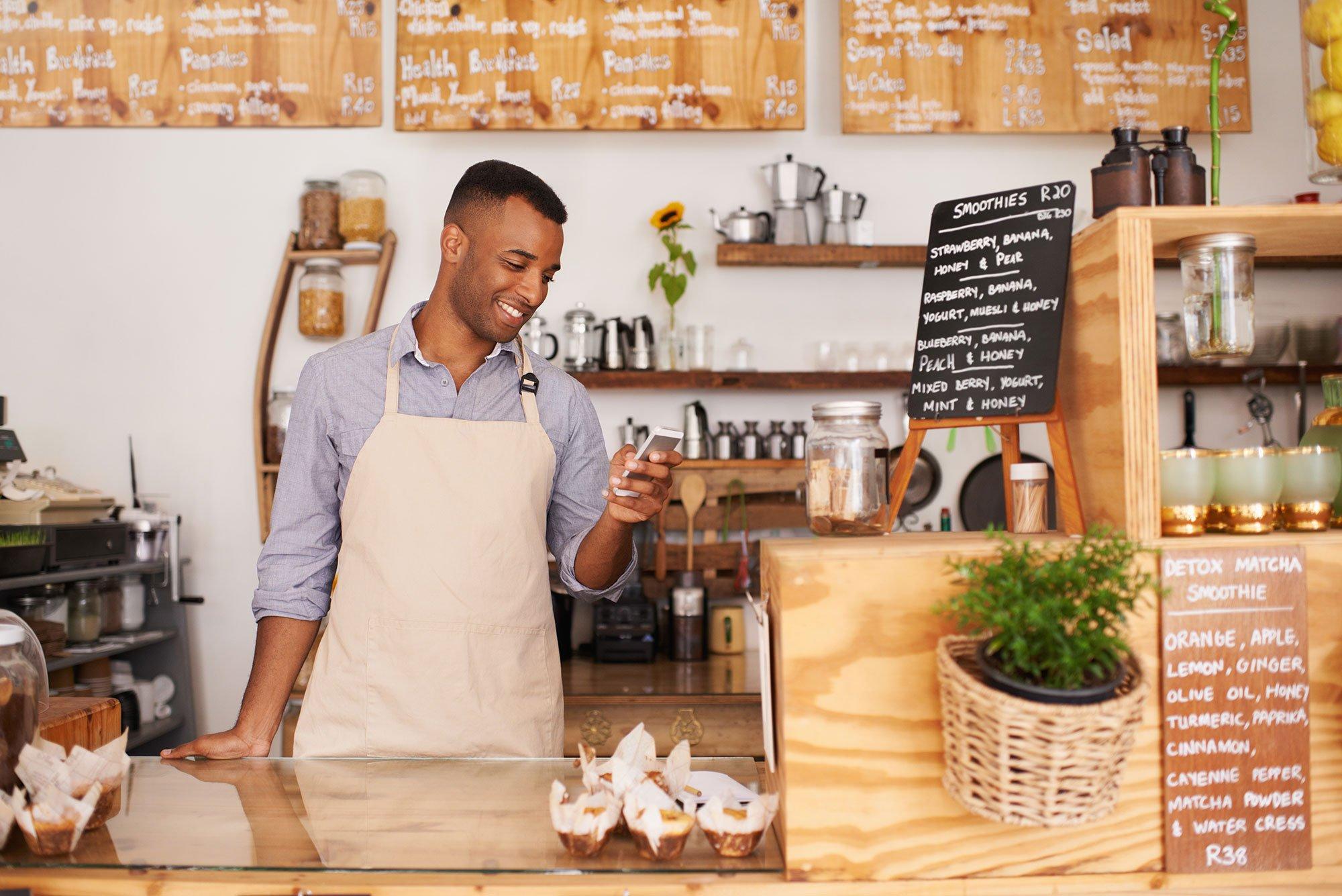 cafe-bakery-employee-using-mobile-phone