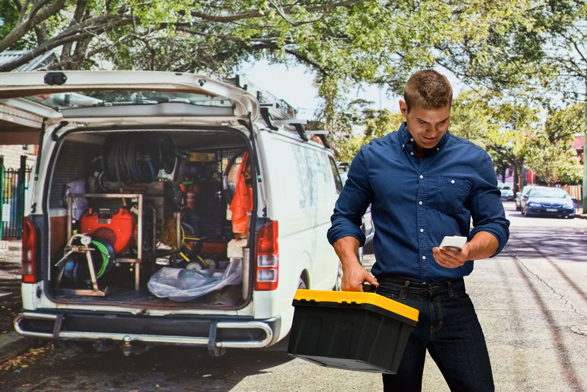 contractor-handyman-plumber-toolbox-van-mobile-phone