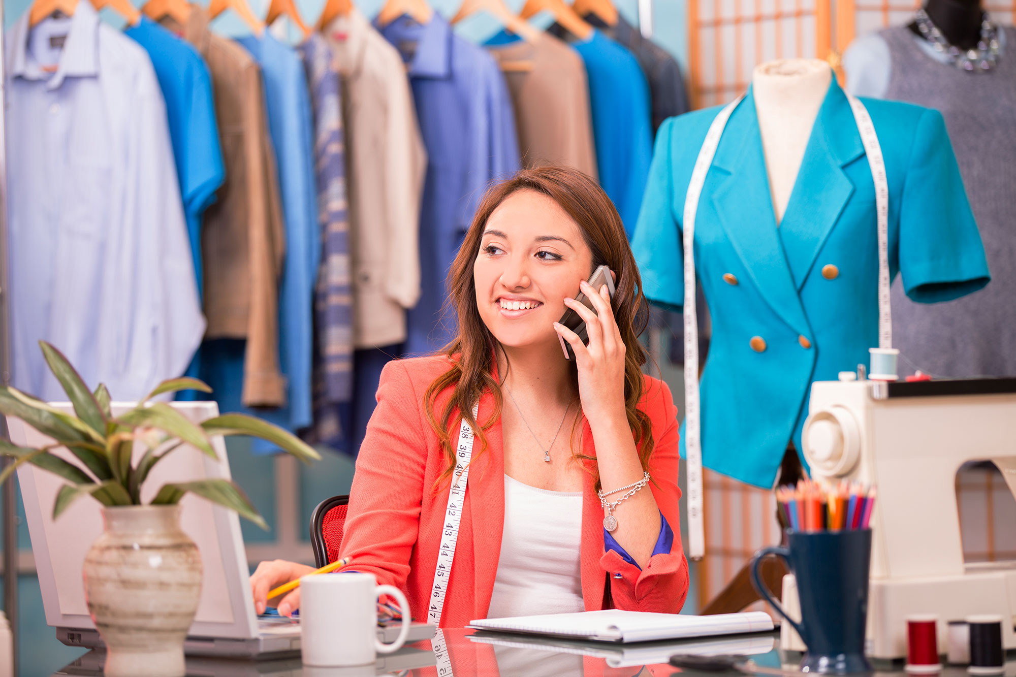 woman-tailor-fashion-small-business-mobile-phone-laptop