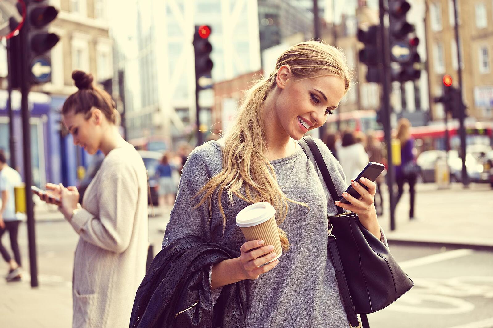women-in-city-street-using-smartphones.jpg