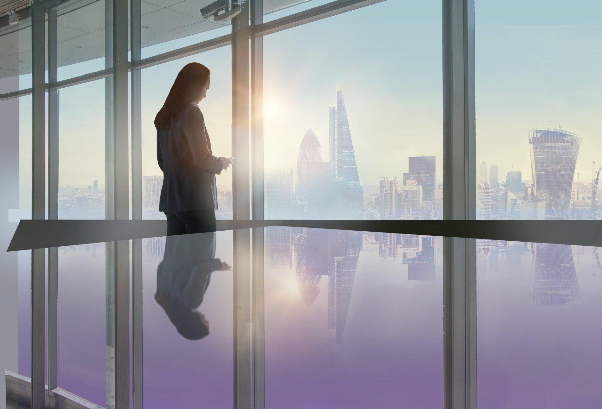 business-women-phone-office-london-sunrise-sunset-24seven