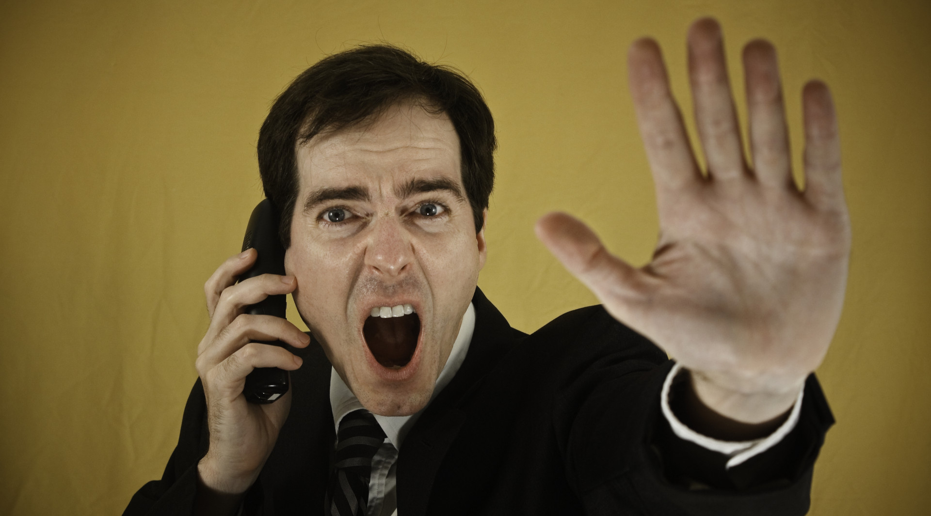 stop-robocalls-blog-man-phone-hand