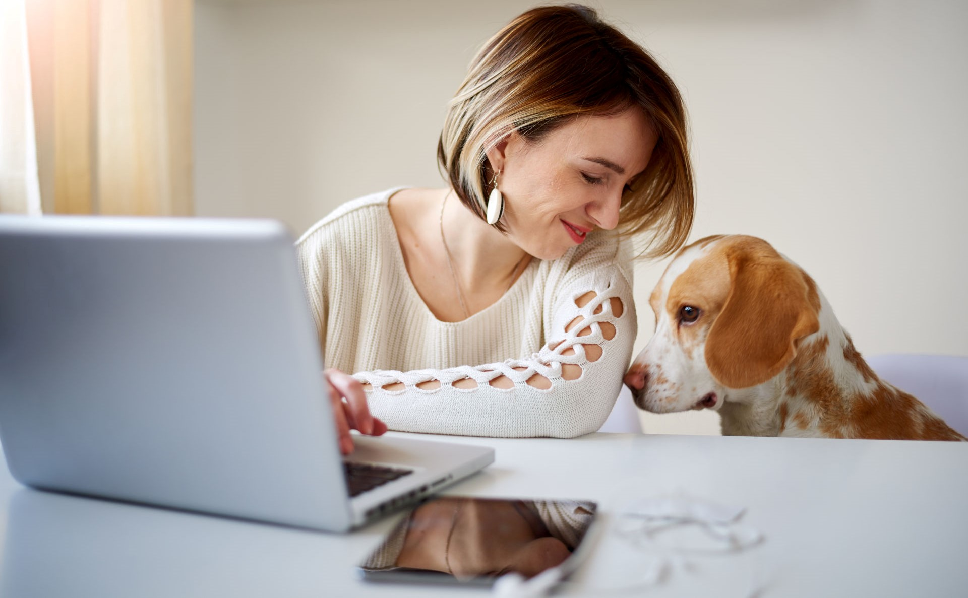 woman-working-from-home-with-dog