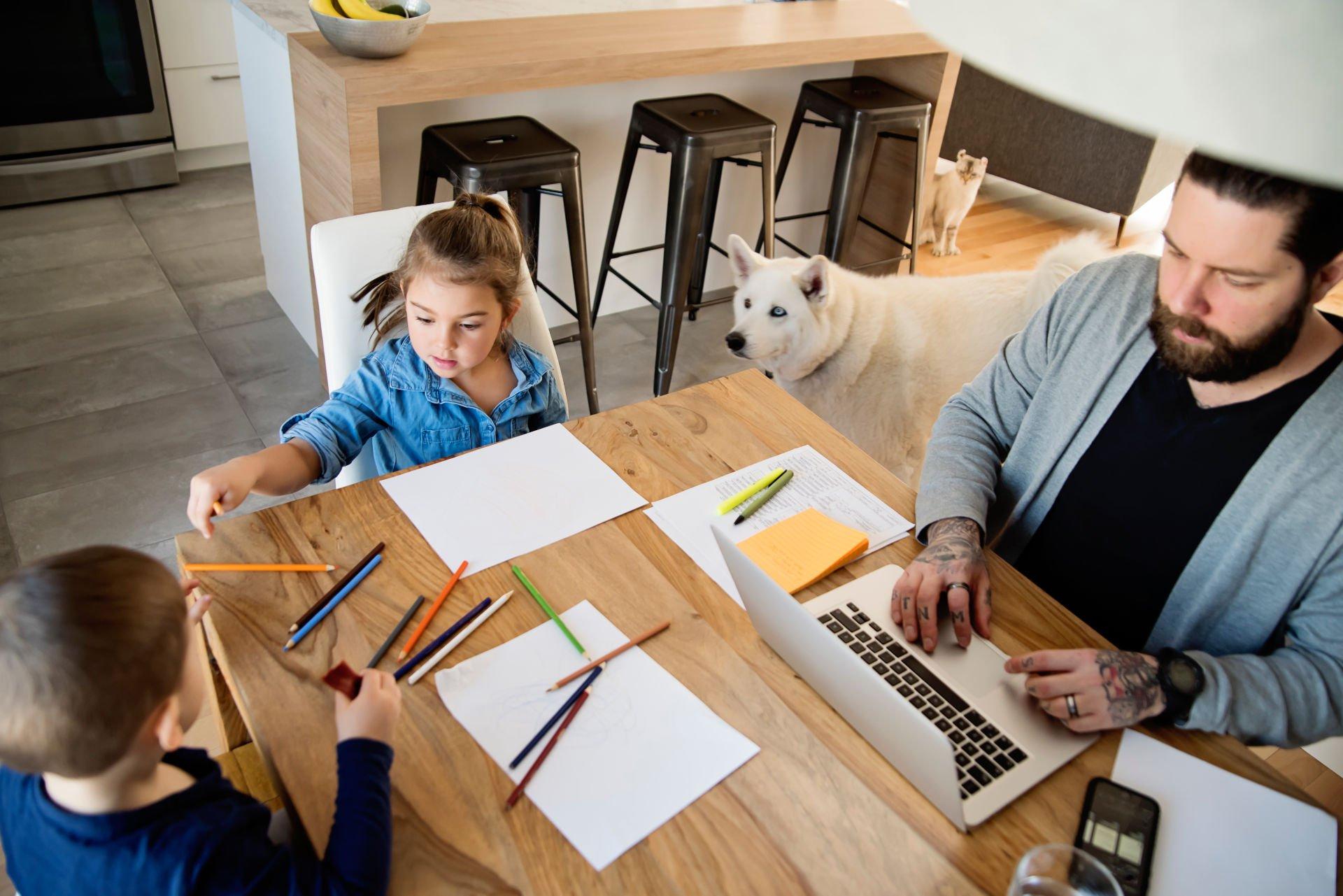 working-from-home-kids-man-dog-cat-kitchen