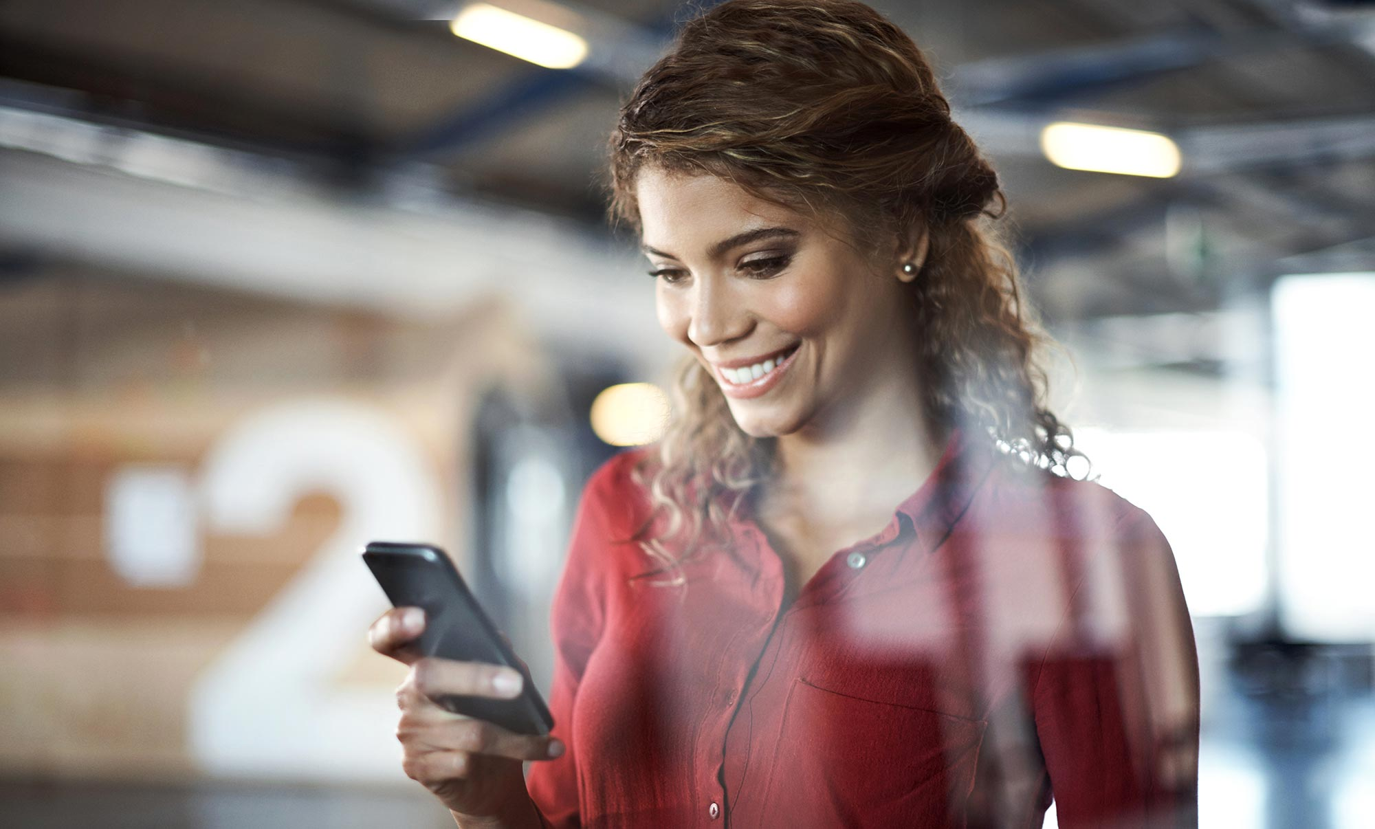 business-woman-smiling-smartphone-reflections.jpg