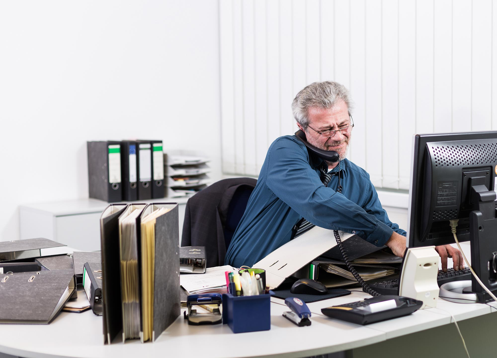 businessman-stressed-on-phone-in-office.jpg